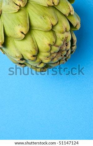 Artichoke on a Vibrant Blue Background.  Food Concept.