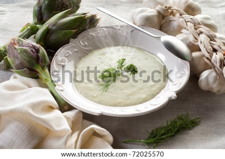 artichoke soup on dish - stock photo