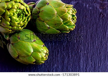 artichokes on a dark background