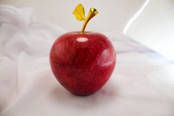 artificial apple on a green elephant leave