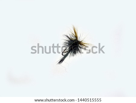 Artificial blue fly fishing fly