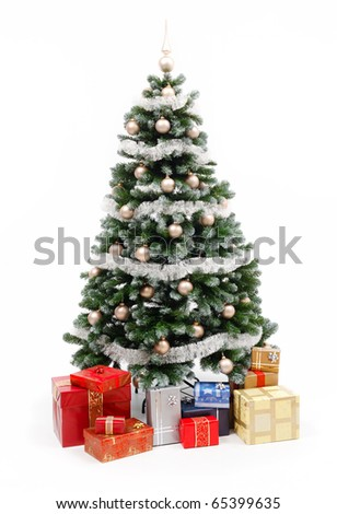 Artificial christmas tree isolated on white, decorated with golden ornaments and silver garland, a lot of presents under the tree - stock photo