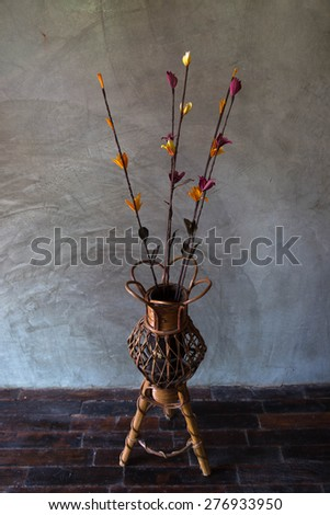 artificial dry flower with the wooden vast, hand made dry flower in the wooden vast style in front of polished cement wall