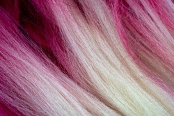 artificial fiber and bright pink fake hair for kanekalon. Close up. Texture. Blond and pink colored kanekalon material for Afro-braids and other hairstyles.