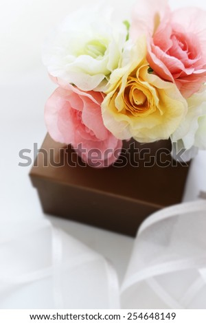 artificial flower bouquet and gift box for holiday image