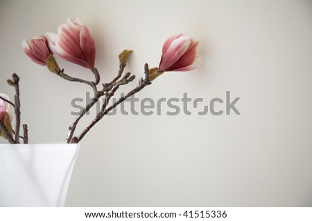 Artificial flower in vase - stock photo