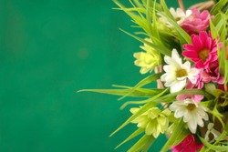Artificial flower in wood basket weave. Soft-focus abstract background.