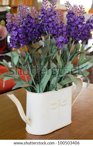Artificial flower of forget me not in galvanized vase
