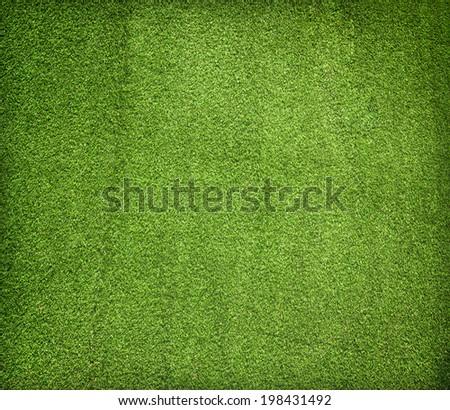 Artificial grass wall. Artificial turf. Thin green plastic. - Shutterstock ID 198431492