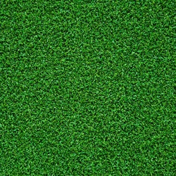 Artificial green grass carpet forming a seamless abstract pattern with natural look
