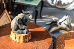 Artificial handcraft small elephant souvenir at Chatuchak outdoor vintage market in Bangkok Thailand
