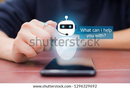 artificial intelligence,AI chat bot concept.Close-up of female hands using mobile phone