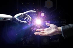 artificial intelligence, future technology and business concept - robot and human hand with flash light and virtual screen projection over black background