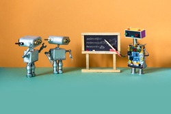 Artificial intelligence machine learning and robotics education concept. Robot teacher explains theory inverse trigonometric functions. College classroom interior with handwritten formula chalkboard.