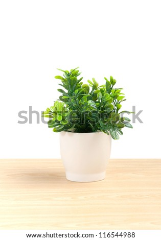 artificial leaf in small porcelain vase for home decoration