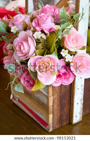 Artificial rose bouquet in wood vase