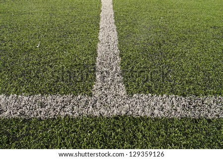 Artificial soccer field with white line
