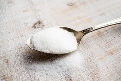 Artificial Sweeteners and Sugar Substitutes in metal spoon. Natural and synthetic sugarfree food additive:  sorbitol, fructose, honey, Sucralose, Aspartame