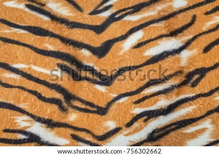 artificial tiger skin pattern baackground