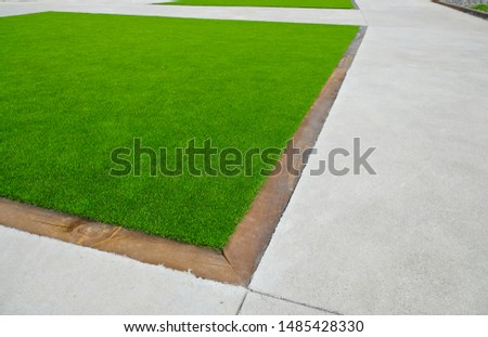 Artificial turf surface used in city landscaping. #1485428330