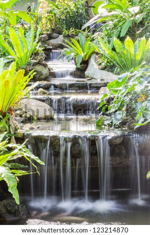 Artificial waterfall in butterfly garden, Thailand - stock photo