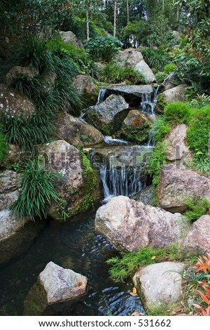 Artificial waterfall in Japanese garden.