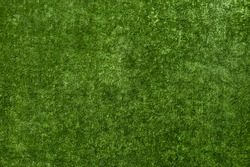 Artificial wear-resistant plastic green lawn or turf texture. For decoration.