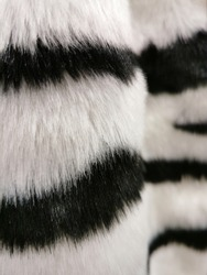 artificial zebra fur, black and white stripes abstract background, selective focus