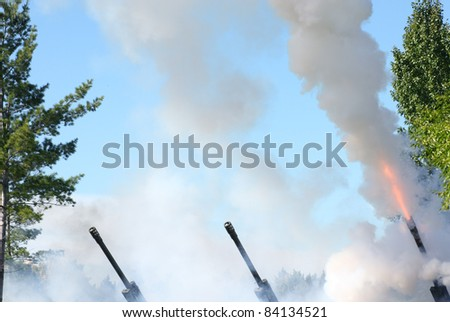 Artillery units firing into the air. - stock photo