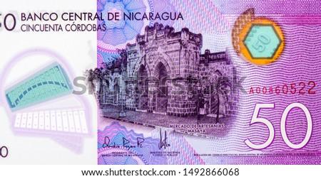 Artisan Crafts Market in Masaya. portrait from Nicaragua 50 Cordobas 2014 Banknotes. Nicaraguan money Closeup Collection. #1492866068