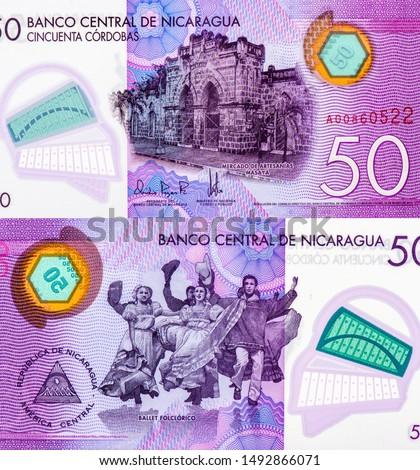 Artisan Crafts Market in Masaya. portrait from Nicaragua 50 Cordobas 2014 Banknotes. Nicaraguan money Closeup Collection. #1492866071