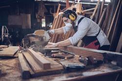 Artisan man Small factory industry, handicraft manufacturer, furniture professional in woodworking. Craftman working workshop maker construction.