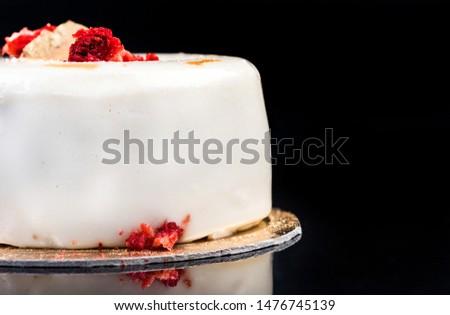 Artisan Monoportion Patisserie Dessert Cake on Black Reflective Background.
