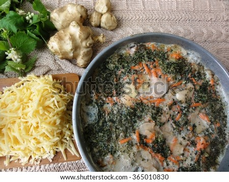 Artishok white-nettle mushrooms gratin, wild plants cooking, healthy food with vegetables and cheese. Artichokes #365010830