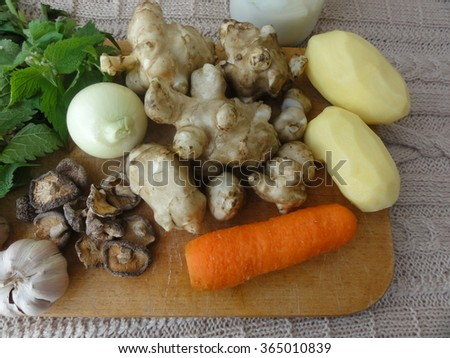 Artishok white-nettle mushrooms gratin with carrot, artishok, potatoes, mushrooms, onion, garlic, wild plants recipes. Cooking healthy food with vegetables. #365010839