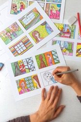 Artist animator draws a color storyboard. Sketches of illustrations for comics or cartoon.