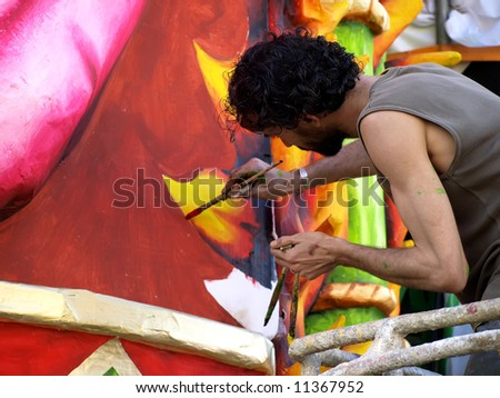 Artist applying final touches to float from the International Carnival of Malta 2008