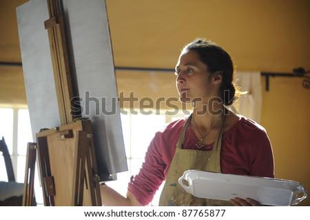 Artist at work in studio.