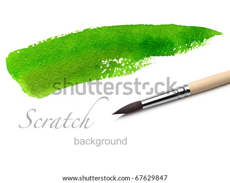 artist brush and green paint scratch