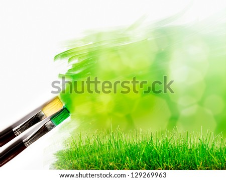 artist brush painting picture of beautiful green grass landscape