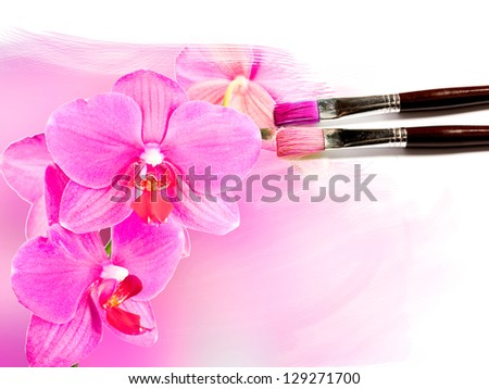 artist brush painting picture of beautiful orchid