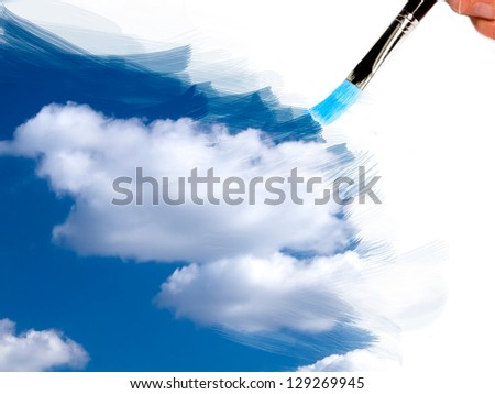artist brush painting sky and clouds