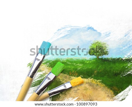Artist brushes with a half finished painted canvas of rural landscape