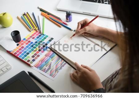 Artist creative graphic designer working on creative desk. #709636966