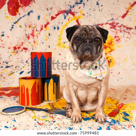 Artist Dog with three paint cans and paint brushes in studio setup - stock photo