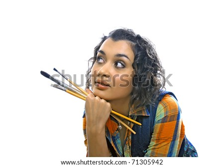 artist-girl. Looking up into the corner - stock photo