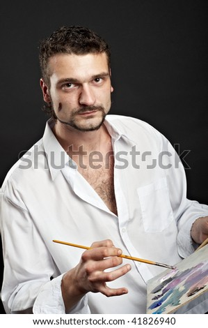 artist in a white shirt with a brush and palette
