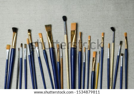 Artist oil Paint Brushes closeup on artistic canvas