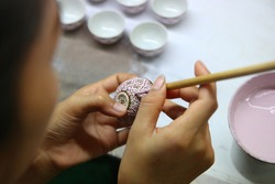 artist painting benjarong ceramic ware , A traditional Thai five-colored famous porcelain