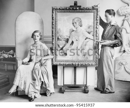 Artist painting portrait of posing woman